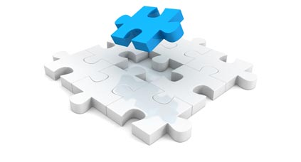 white jigsaw puzzle with blue piece falling into place